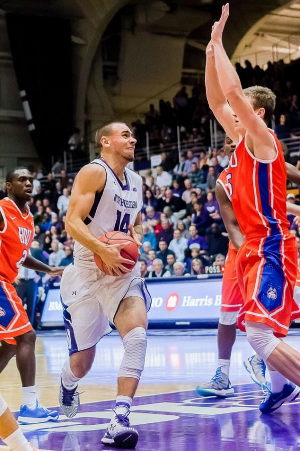 Junior guard Tre Demps drives to the basket. Demps hit a game-winning shot in the waning seconds of Northwestern's 69-67 win over North Florida.