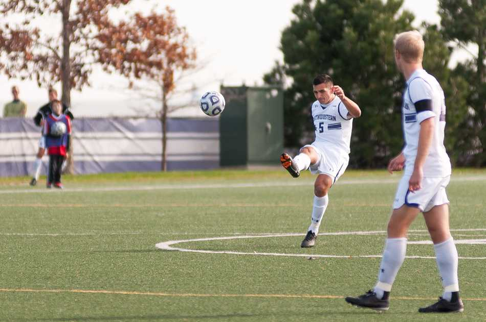 Nikko Boxall plays a ball forward. The senior centerback was named Big Ten Defensive Player of the Year for his role in leading the Cats' stingy defense.