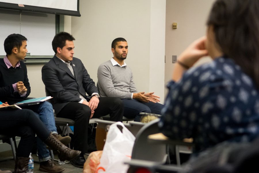 Michael Martinez, a co-founder of hip-hop group Don't Only Just Observe, speaks about the importance of music in communities at a panel event hosted by Northwestern Community Development Corps. The panelists were all members of organizations that promote music, writing and art.