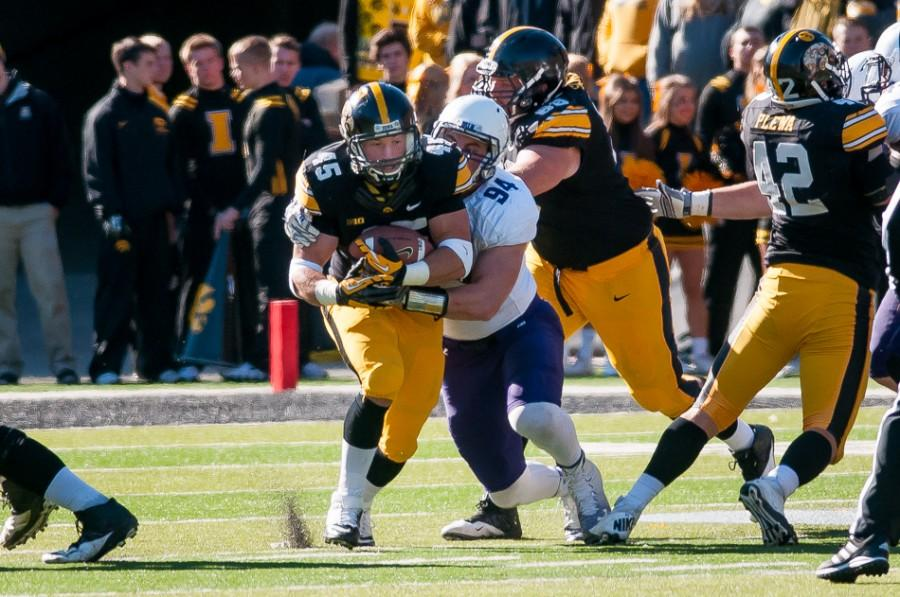 Iowa running back Mark Weisman carries in the first half. Weisman had three first-half touchdowns as the Hawkeyes raced out to a 38-7 lead over Northwestern.