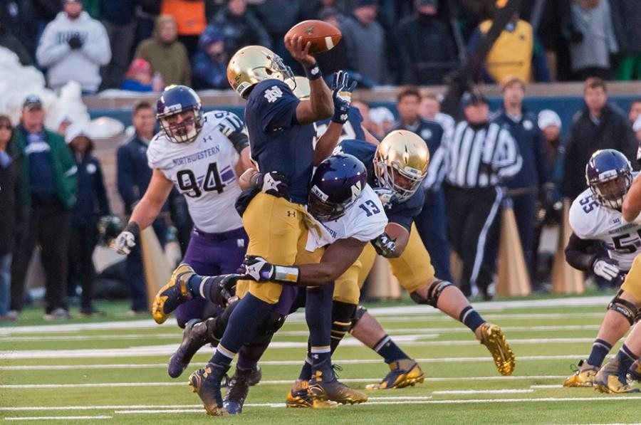 Junior+defensive+end+Deonte+Gibson+hits+Notre+Dame+quarterback+Everett+Golson+during+Northwestern%E2%80%99s+43-40+victory+over+the+Fighting+Irish.+The+Wildcats+need+to+win+their+final+two+games+to+qualify+for+a+bowl.