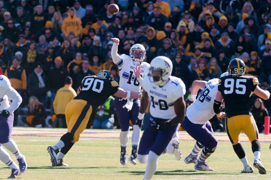 Iowa defensive lineman Louis Trinca-Pasat hits junior quarterback Zack Oliver. Oliver struggled after replacing senior Trevor Siemian under center, going 1-of-6 for 7 yards in the fourth quarter of Northwestern's 48-7 loss to Iowa on Saturday.