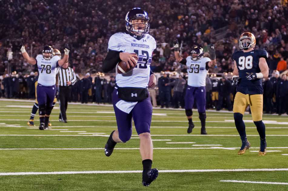 Senior quarterback Trevor Siemian runs in for a six-yard touchdown in the fourth quarter. Siemian looked as mobile as he has all season, throwing for 284 yards and running for 32 in Northwestern's 43-40 victory over No. 18 Notre Dame.