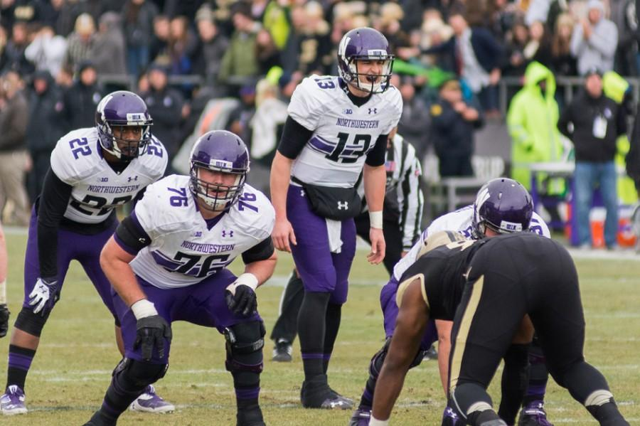 Senior+quarterback+Trevor+Siemian+prepares+to+take+a+snap+against+Purdue.+Siemian+injured+his+knee+later+in+the+game+and+will+miss+the+rest+of+Northwestern%E2%80%99s+season.