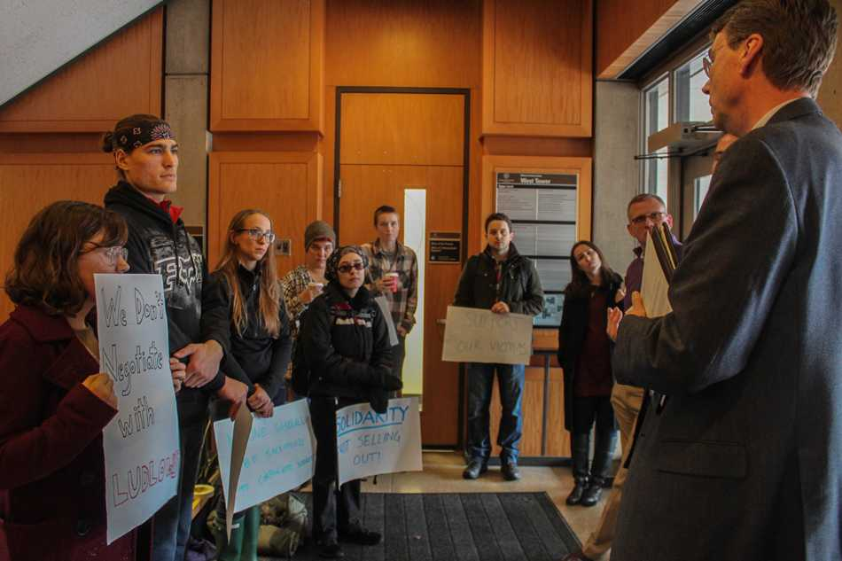 Students who planned a sit-in protest in the Rebecca Crown Center listen as Northwestern administrators explain a lawsuit filed against the University by philosophy Prof. Peter Ludlow. NU decided Monday not to mediate on behalf of all the defendants, including a graduate student who accused Ludlow of non-consensual sex.