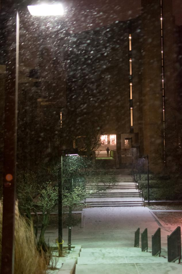 Snow falls outside of Norris University Center on Monday night. Ahead of the upcoming 2014-15 winter, Evanston started a campaign called Snow Awareness Week on Monday to secure community members' preparedness for the snowfall.