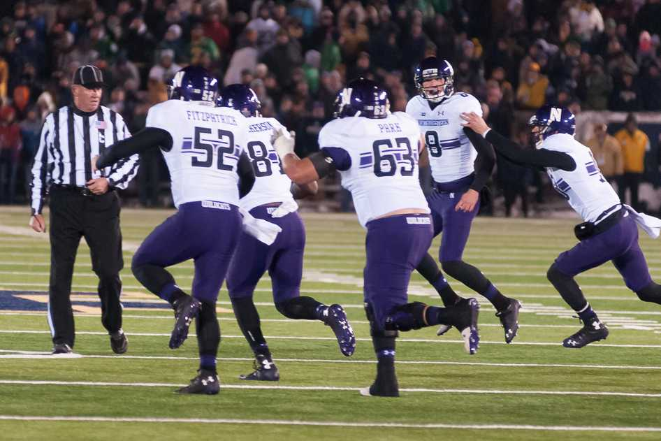Northwestern players celebrate with sophomore kicker Jack Mitchell after Mitchell hit a 41-yard field goal in overtime to beat No. 18 Notre Dame 43-40. It was Mitchell's third field goal of more than 40 yards on the day.