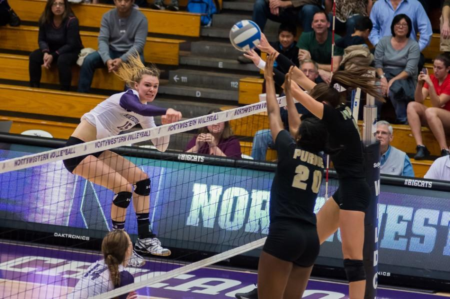 Kayla Morin delivers a spike in the Wildcats' first game against the Boilermakers. The sophomore outside hitter has started every match and is second on the team in kills.