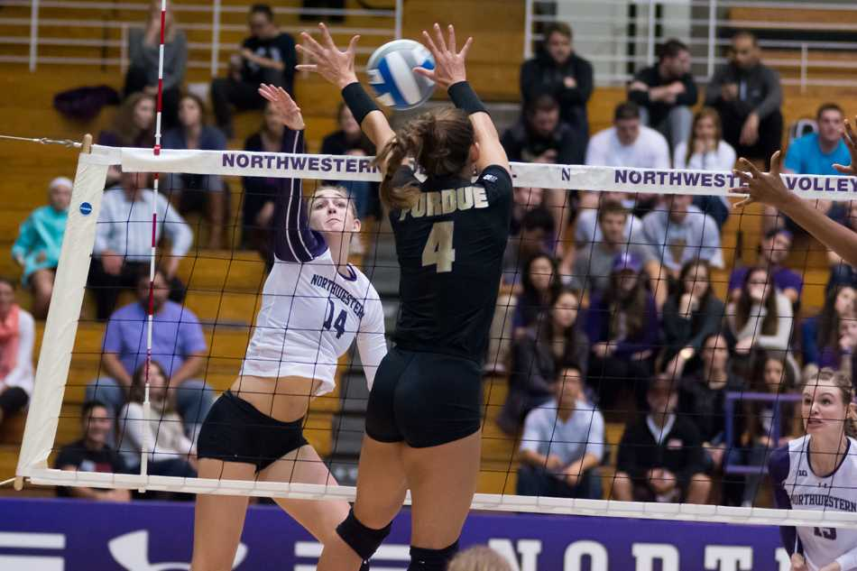 Senior Katie Dutchman battles a Purdue defender at the net in a recent match. Dutchman and the Wildcats lost their fourth straight match Wednesday, falling to Michigan State in four sets.