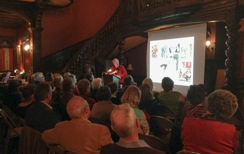 Janet C. Messmer, costume curator at the Evanston History Center, gives a lecture to about 50 people Thursday night. As part of the history center's