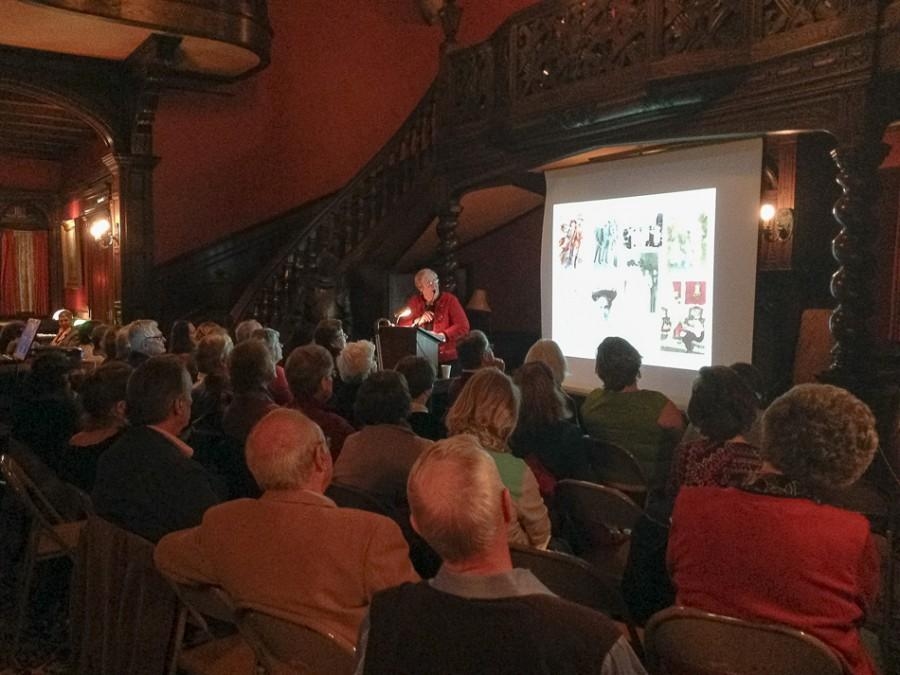 Janet C. Messmer, costume curator at the Evanston History Center, gives a lecture to about 50 people Thursday night. As part of the history center's Under the Buffalo series, Messmer spoke about how World War I influenced the fashions and social customs of the time.