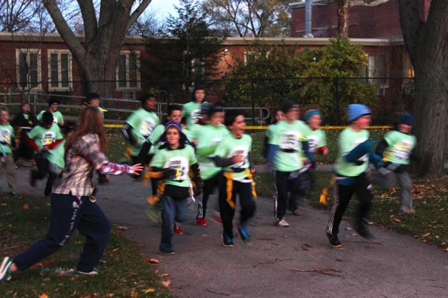 Children+and+families+run+from+volunteers+dressed+as+zombies+during+Evanston%E2%80%99s+first+Zombie+Scramble.+The+event+was+hosted+by+the+city%E2%80%99s+Parks%2C+Recreation+and+Community+Services+department+and+included+races+for+both+families+and+adults.