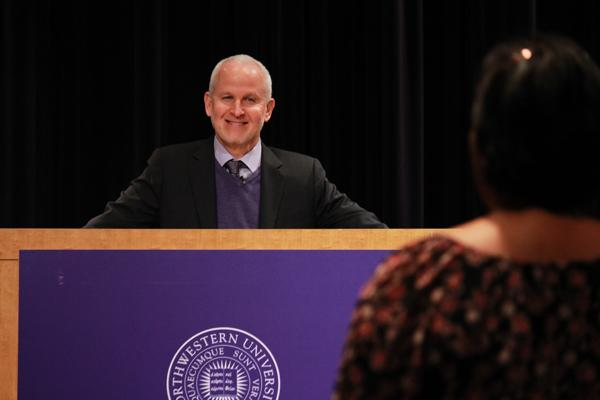 University President Morton Schapiro speaks to members of the Northwestern community during a forum in 2013. Trustees announced Tuesday they had decided to extend Schapiro's contract as president through August 2022.