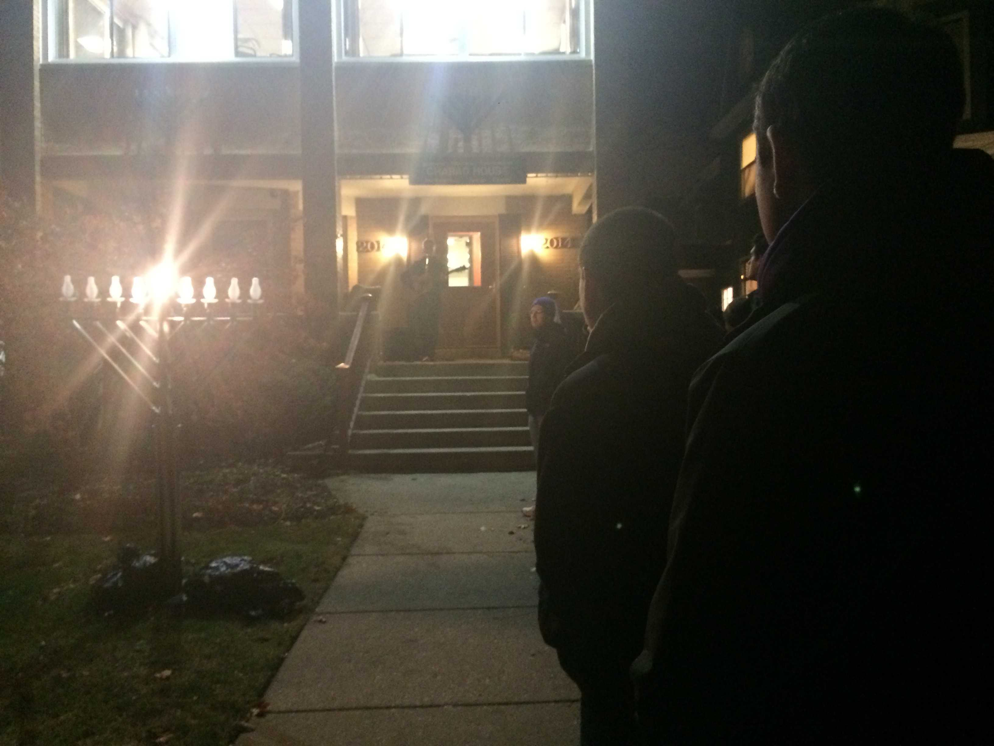 Medill sophomore Noah Fromson plays a song Tuesday night on the steps of the Tannenbaum Chabad House, 2014 Orrington Ave. About 50 student representative gathered and spoke about tolerance at the commemoration of the Chabad House's new menorah, which was replaced after it was vandalized in October.