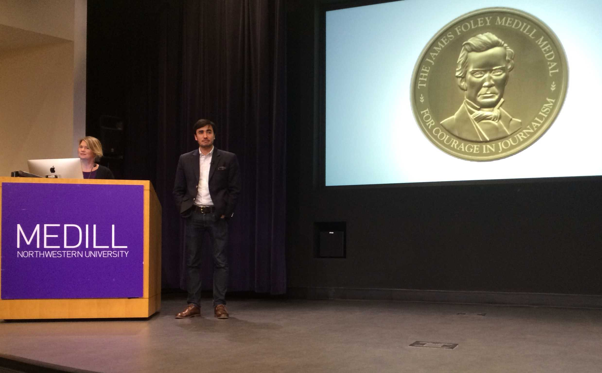 Journalist Matthieu Aikins accepts the James Foley Medill Medal for Courage in Journalism for his reporting in Afghanistan. Aikins and slain journalist James Foley were both awarded the medal this year for their work in war zones.