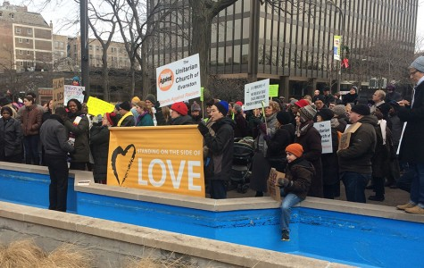 Protesters gather at Fountain Square in downtown Evanston on Sunday afternoon. Local religious groups hosted the peaceful demonstration to demonstrate solidarity and call for racial justice in response to the lack of indictments in the Eric Garner and Michael Brown cases.