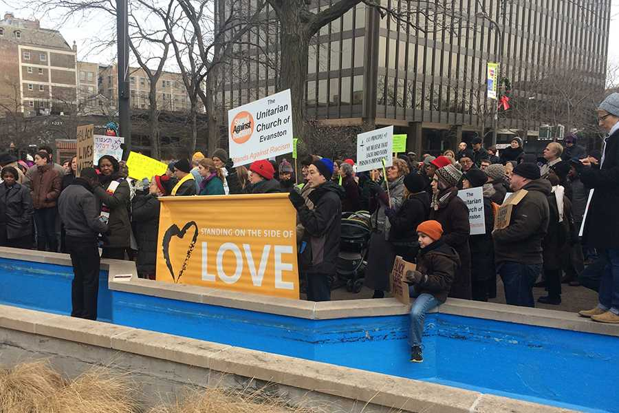 Protesters+gather+at+Fountain+Square+in+downtown+Evanston+on+Sunday+afternoon.+Local+religious+groups+hosted+the+peaceful+demonstration+to+demonstrate+solidarity+and+call+for+racial+justice+in+response+to+the+lack+of+indictments+in+the+Eric+Garner+and+Michael+Brown+cases.