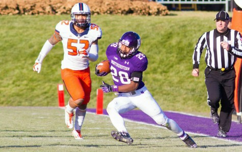 Justin Jackson cuts away from the sideline during Northwestern's loss to Illinois last Saturday. After a stellar freshman season, the running back is a key part of the Wildcats' future in 2015 and beyond.