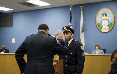 Evanston police Sgt. Jodie Hart is sworn in Monday evening. Hart received a promotion along with two of his colleagues.