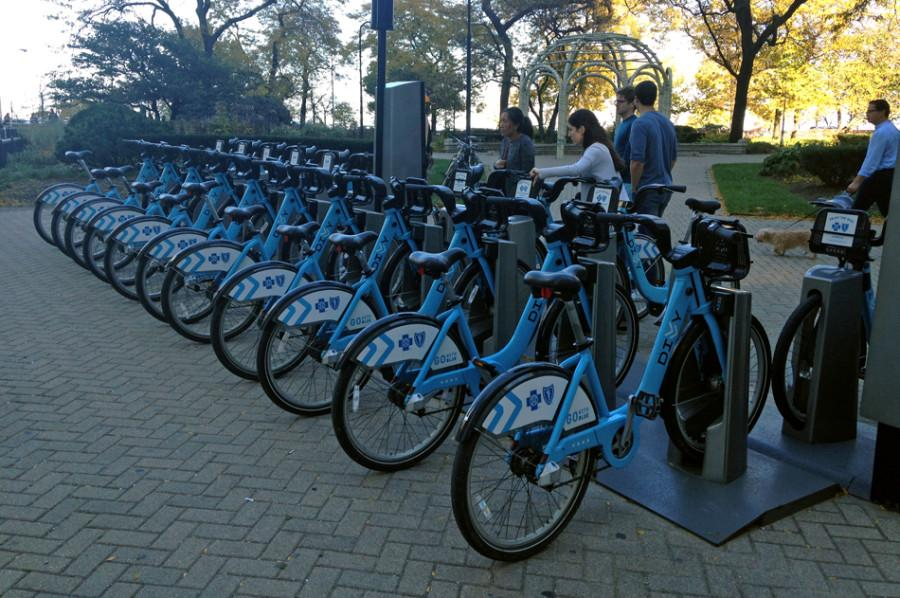 Residents rent Divvy bikes in downtown Chicago. The Chicago-based bike-sharing program will expand to Evanston in the spring.