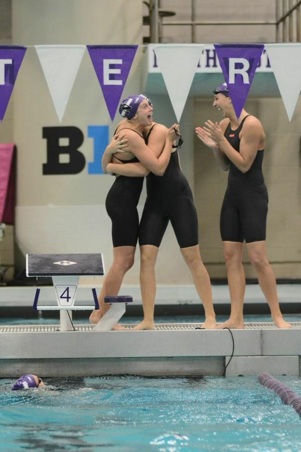 The+Wildcats+celebrate+an+emotional+senior+day+at+Friday%27s+meet+at+the+Norris+Aquatics+Center.+Northwestern+won+all+11+swimming+events+in+the+competition+against+the+Milwaukee+Panthers.