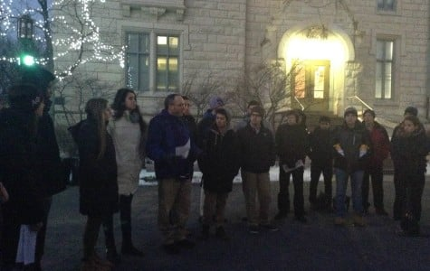 Northwestern Hillel director Michael Simon reads the names of the victims of the recent terrorism in Paris. About 40 members of the NU community gathered at The Rock on Friday to remember and mourn the victims.