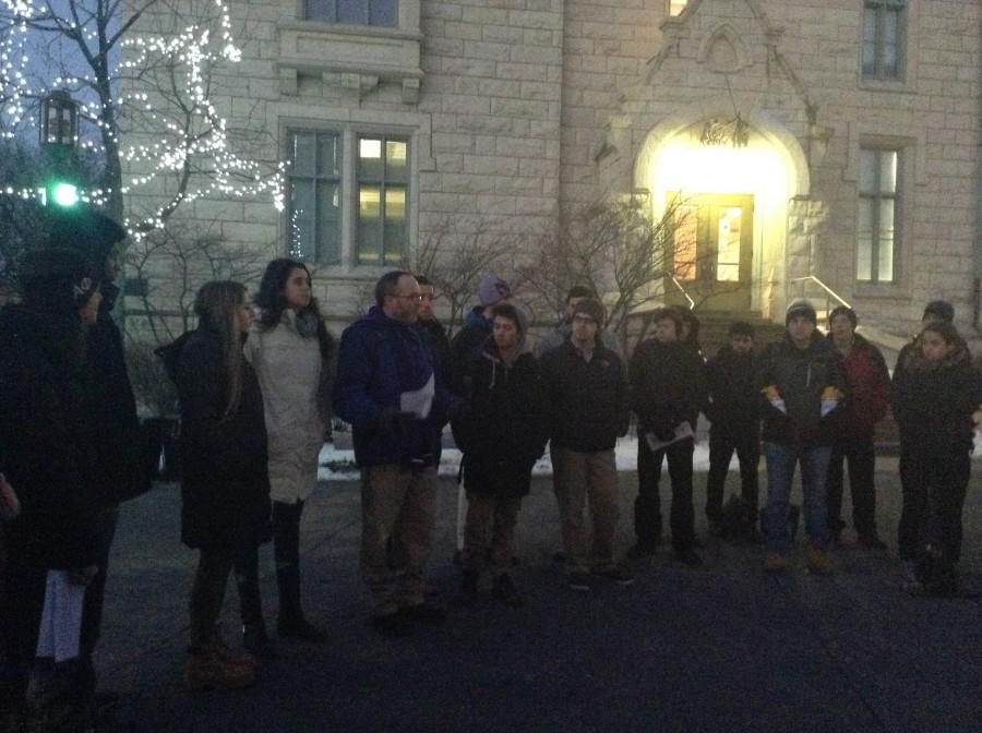 Northwestern+Hillel+director+Michael+Simon+reads+the+names+of+the+victims+of+the+recent+terrorism+in+Paris.+About+40+members+of+the+NU+community+gathered+at+The+Rock+on+Friday+to+remember+and+mourn+the+victims.