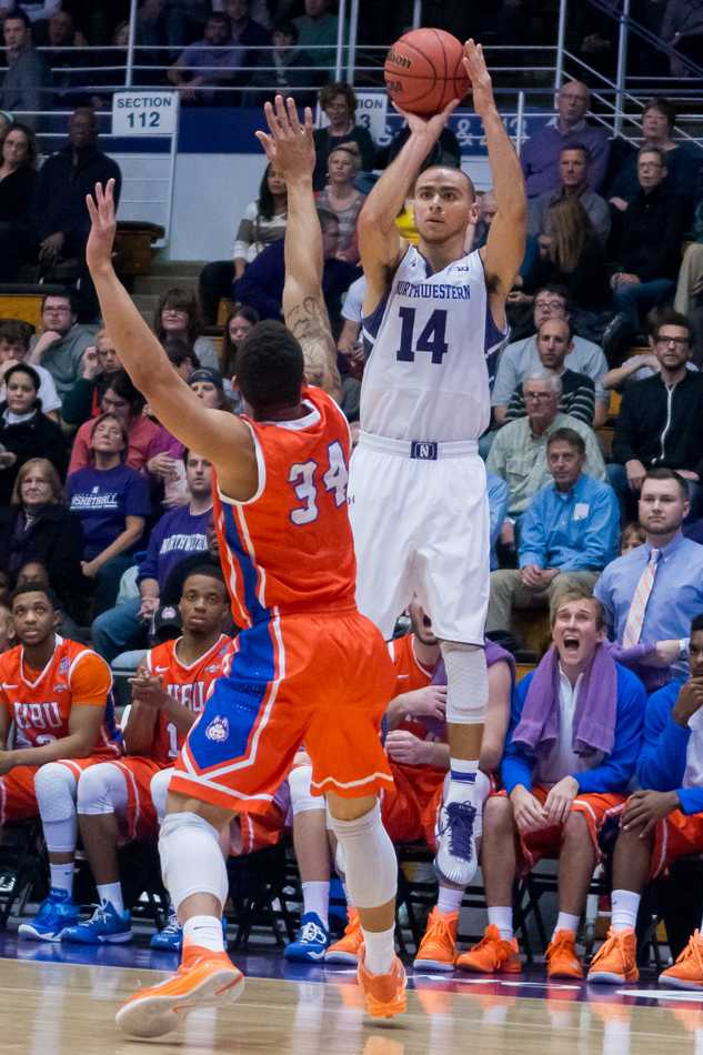 Tre Demps elevates for a shot over a defender. The junior guard leads Northwestern in scoring but is focused on his defensive game against Illinois.
