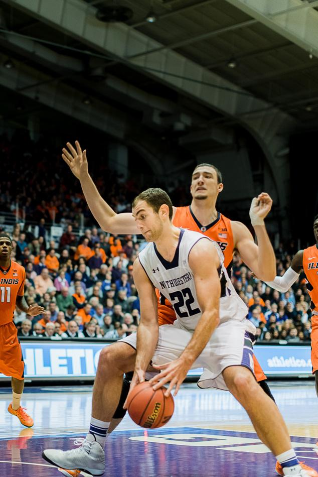 Junior center Alex Olah posts up an Illinois defender. The Wildcats lost 72-67 to the Fighting Illini despite Olah's 14 points and 12 rebounds.