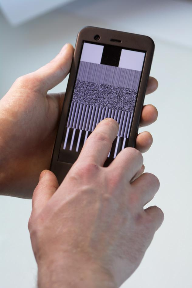 "On the TPad Phone, users can ""feel"" an image displayed on a touchscreen. The new device, developed by two Northwestern graduate students, allows textures to be sensed through a special touchscreen technology."