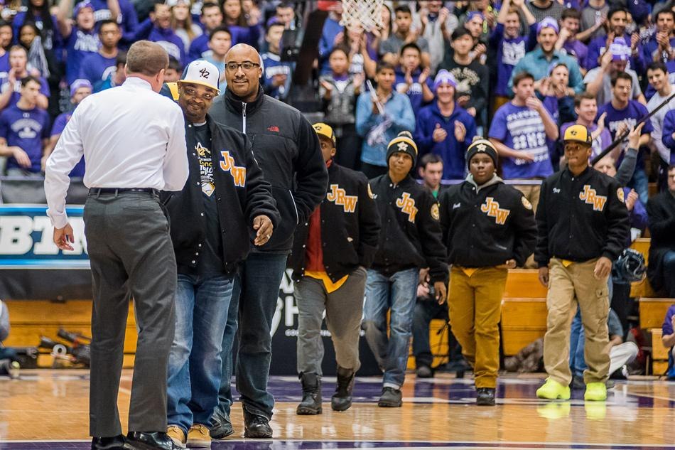 The Jackie Robinson West baseball squad shakes hands with Northwestern athletic director Jim Phillips. The Chicago-based team was honored for its accomplishments at this summer's Little League World Series on Wednesday night at Welsh-Ryan Arena, receiving a standing ovation from the crowd.