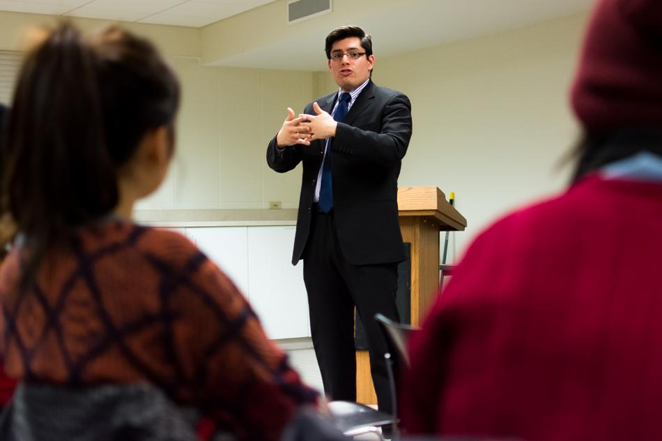 Carlos Rosa speaks about the importance of neighborhood relationships. Rosa, a community organizer running for alderman, spoke Thursday at the Sheil Catholic Center.