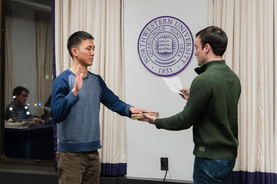 Weinberg+junior+Kenny+Mok+is+sworn+in+as+Associated+Student+Government%E2%80%99s+student+groups+vice+president.+ASG+Senate+unanimously+confirmed+Mok+for+the+position+at+its+meeting+Wednesday.