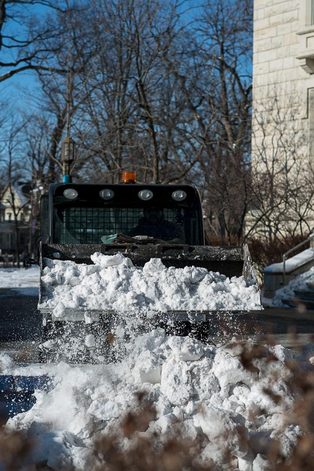 A plow clears snow during a period of extreme temperatures in Evanston. The city has responded to this weather by keeping facilities open for residents to warm up in and by encouraging weather-related calls to 311, among other practices.