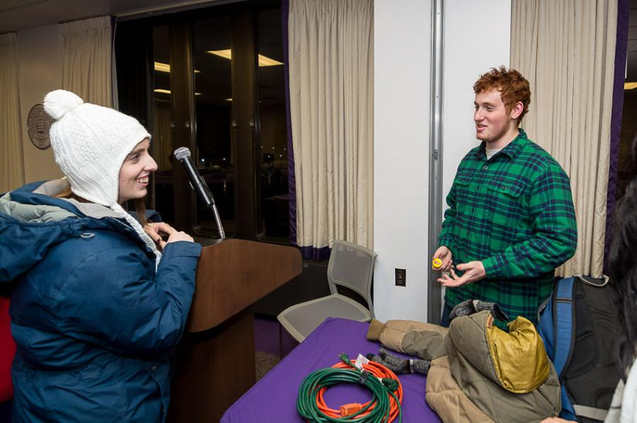 "Weinberg junior Noah Star, Associated Student Government Senate Speaker, talks with a senator after Wednesday night's short meeting. During its meeting, the ASG Senate proposed changing the name of the Diversity and Inclusion Committee to the ""Accessibility and Inclusion Committee."""