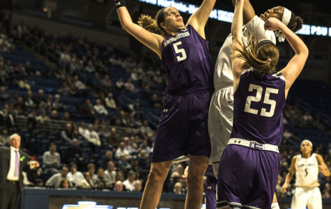 Alex Cohen goes for the block. The senior center fouled out late in the second half, allowing Penn State key rebounding chances against Northwestern's four-guard lineup.