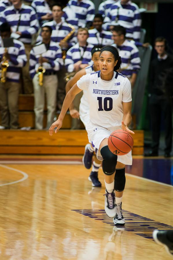 Nia+Coffey+brings+the+ball+up+the+floor.+The+sophomore+forward+was+a+monster+on+the+glass+against+Iowa%2C+pulling+down+six+offensive+rebounds+among+15+total+boards%2C+but+she+could+only+manage+4-of-22+shooting+from+the+floor.