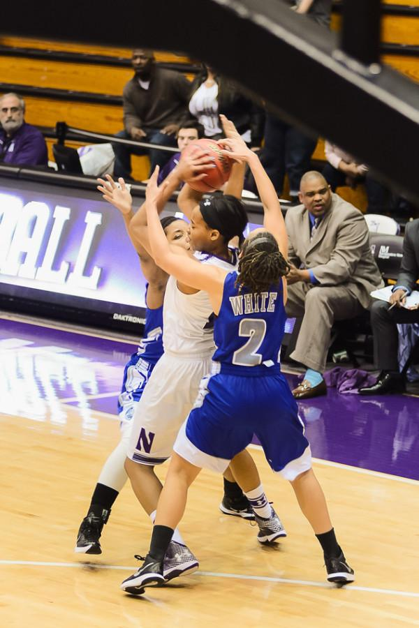 Lauren+Douglas+is+double+teamed+on+the+perimeter.+The+Wildcats%27+loss+to+Michigan+was+the+team%27s+second+in+row.