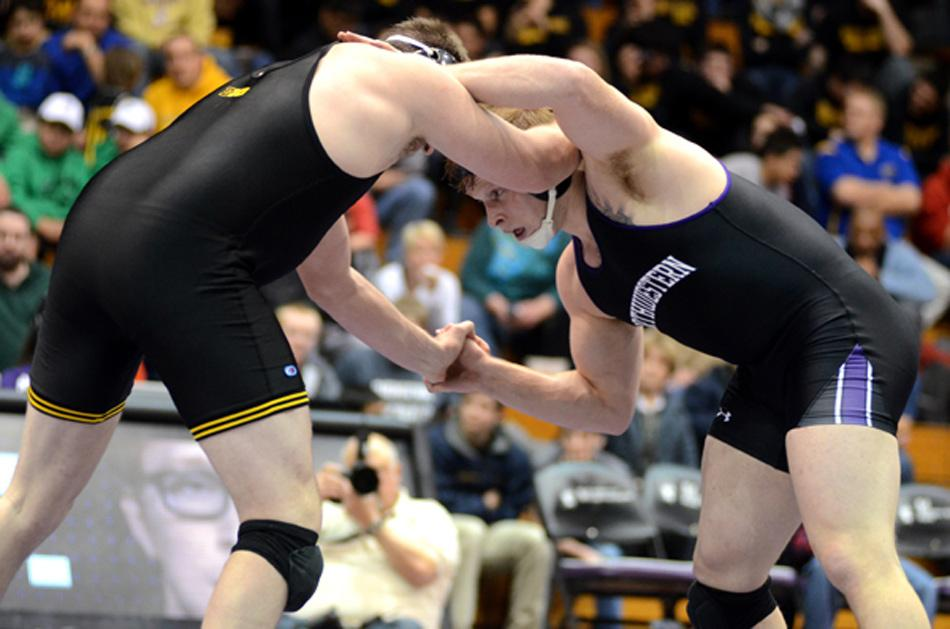 Senior Mike McMullan wrestles an opponent. Sophomore Jason Tsirtsis may garner the most attention, but McMullan is a three-time All-American at NU and currently ranks No. 2 in his weight class.