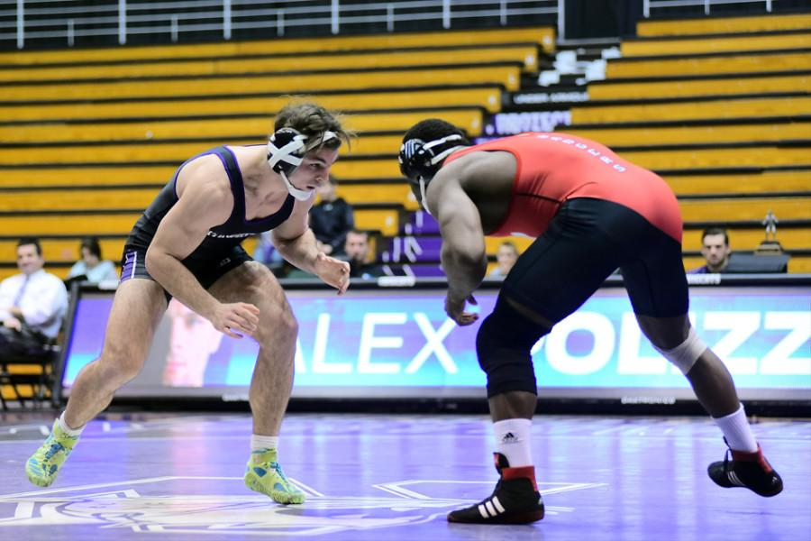 Senior+Alex+Polizzi+gets+set+to+wrestle.+The+No.+13+at+197+pounds+was+one+of+the+team%E2%80%99s+few+bright+spots+this+weekend%2C+nearly+defeating+Iowa+No.+4+Nathan+Burak+on+Friday+and+taking+down+Illinois%E2%80%99+Jeff+Koepke+on+Sunday.