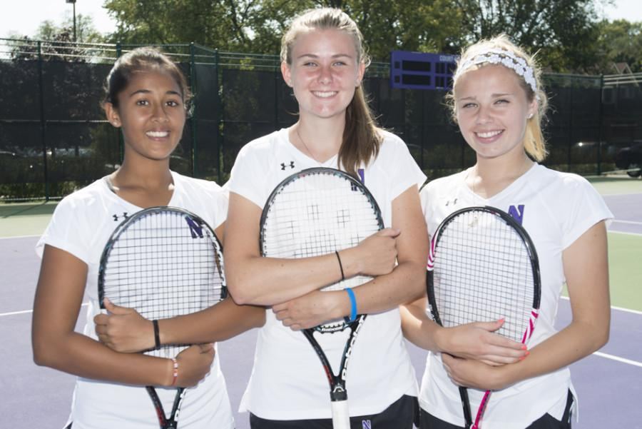 Tennis freshmen Rheeya Doshi, Erin Larner and Alex Chatt pose together. The trio is poised to continue the winning ways of Northwestern's women's tennis program.
