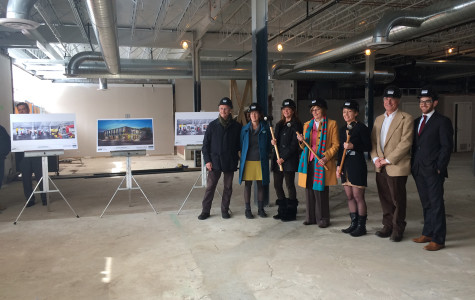 City officials, architects working on the new Evanston Art Center and center employees pose with sledgehammers and hardhats at the site's groundbreaking Thursday. The new center, located on Central Street, is scheduled to be completed by early May.