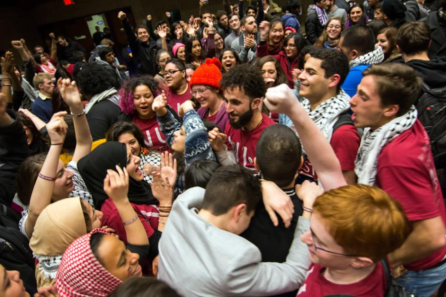Students+celebrate+after+Associated+Student+Government+Senate+passed+a+Northwestern+Divest-sponsored+resolution+just+before+1%3A30+a.m.+Thursday.+The+resolution+passed+with+24+votes+in+favor%2C+22+votes+against+and+three+abstentions.