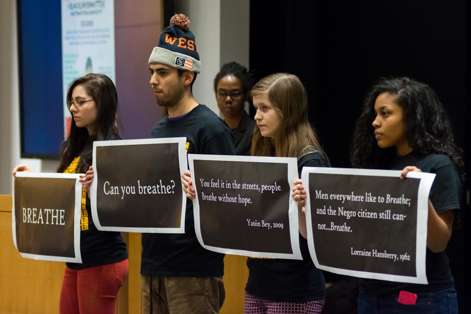 Students silently hold signs displaying quotes during a teach-in hosted by the Black People Making History Committee on Tuesday. The packed event featured discussions about the Black Lives Matter movement.