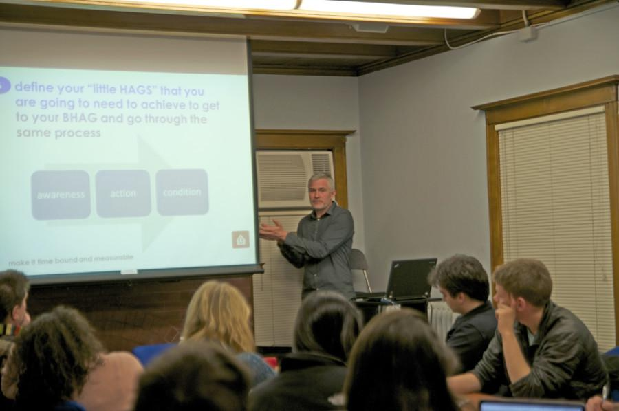 Greg Van Kirk, founder of Social Entrepreneur Corps and co-creator of the MicroConsignment Model for community development, speaks to a group of students interested in social work abroad. Van Kirk has worked in Latin America helping isolated, low-income villages.
