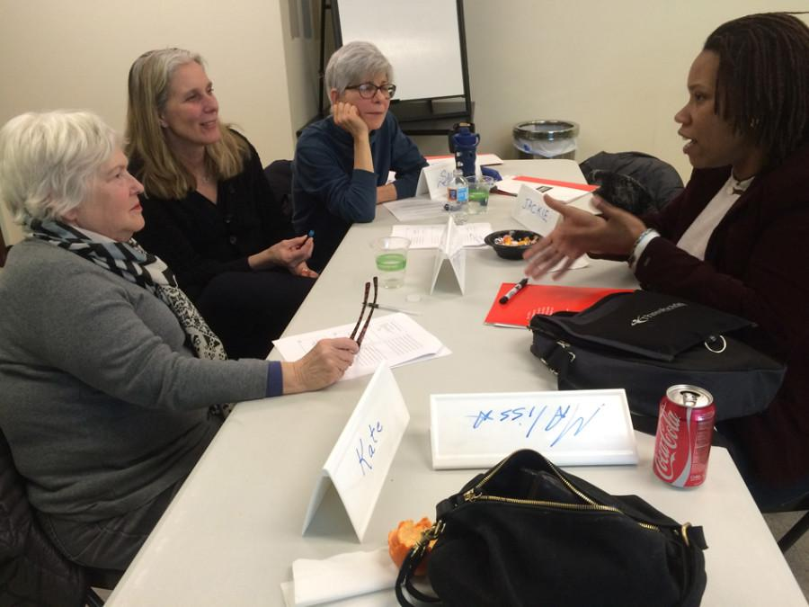 Participants in the second session of YWCA Racial Equity Training discuss examples of different types of racism. The session focused on differentiating between race and racism and is part of a four-session series.