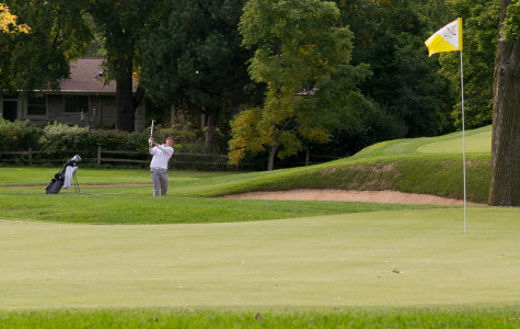 Bennett Lavin blasts one out from the fairway bunker. The senior was a steady No. 3 in the lineup during the fall season.