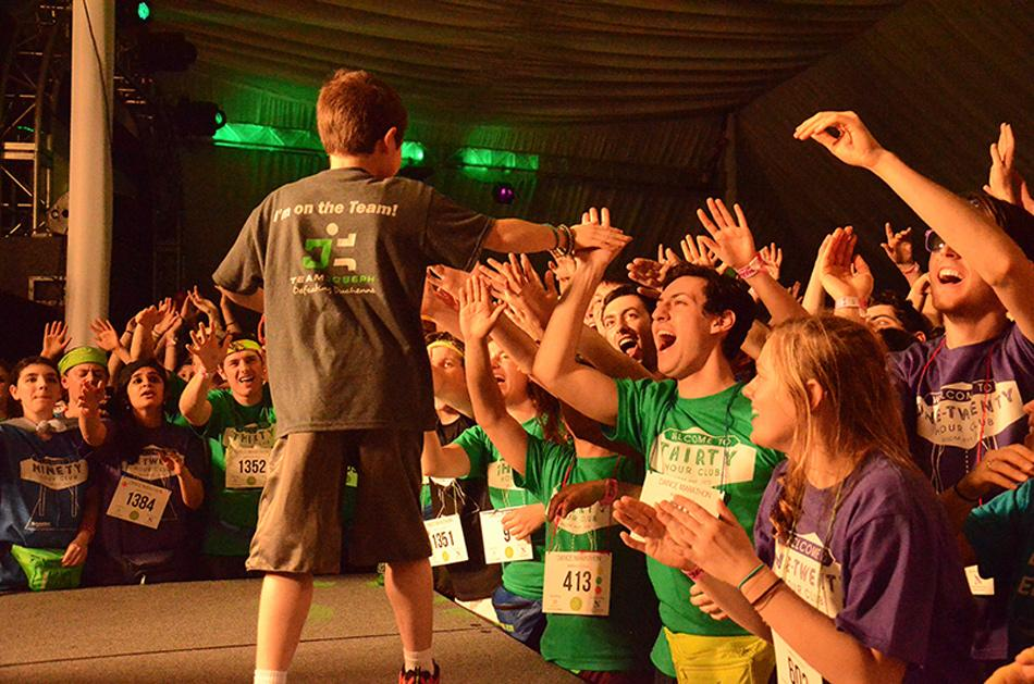 Dancers celebrate during Dance Marathon 2014. This year, almost three times more participants than last year received scholarships to cover DM's registration fee.