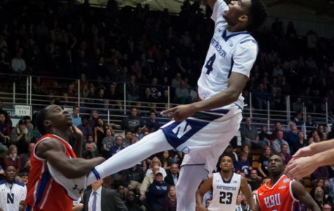 Vic Law finishes off the dunk. The freshman forward played to his potential, throwing down 17 points, grabbing 11 boards and catalyzing a blowout Northwestern victory.