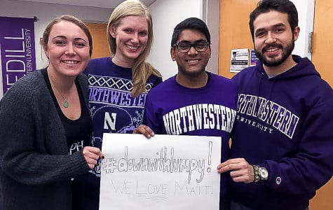 Medill juniors Ellie Friedmann, Rachel Fobar, Orko Manna and A.J. Vielma hold a #DownWithLumpy sign. The four students, who took a class with Medill Prof. Matt Paolelli their freshman year, took a photo to support the professor through his cancer treatment.